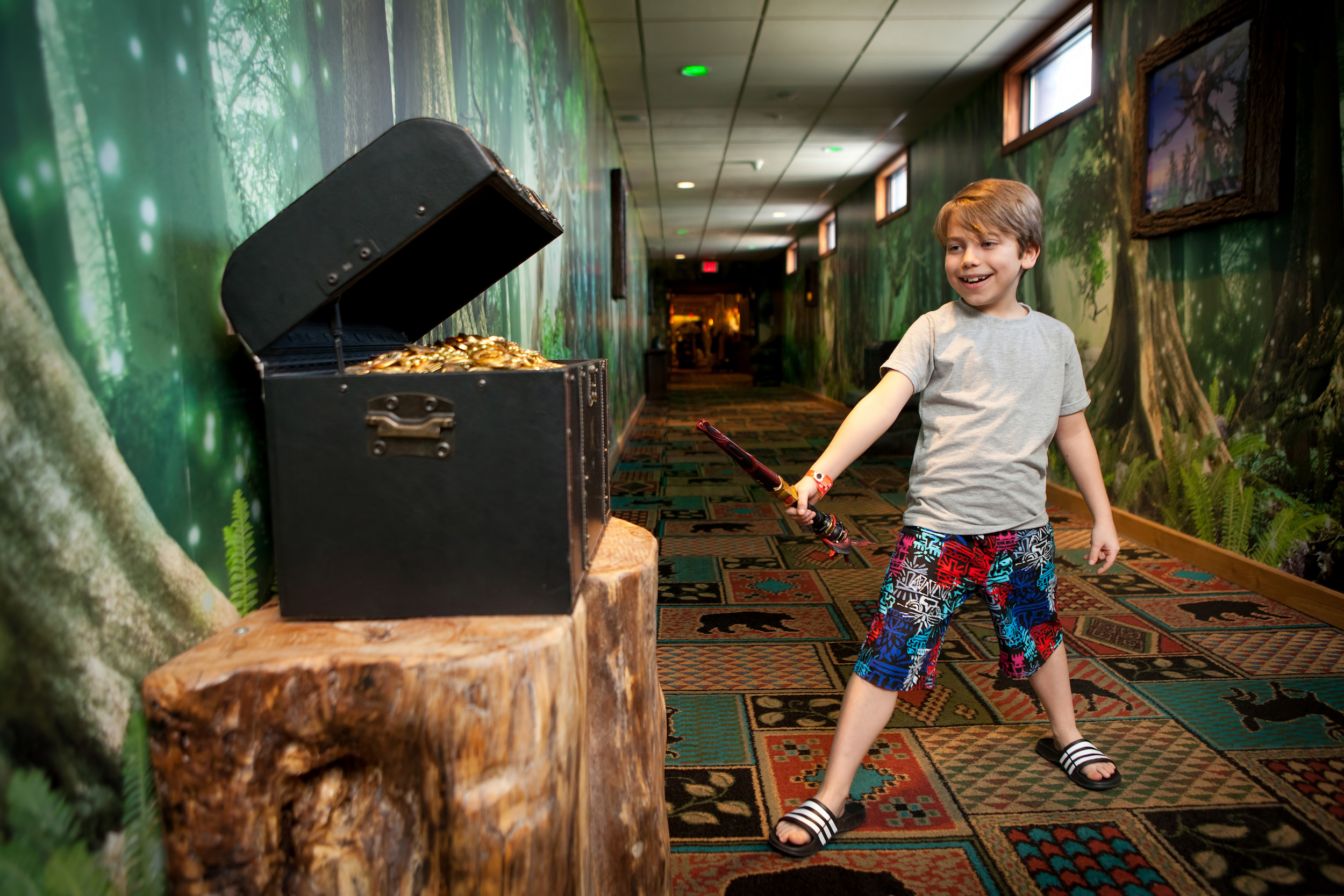 Young boy playing MagiQuest Photo courtesy of Great Wolf Lodge