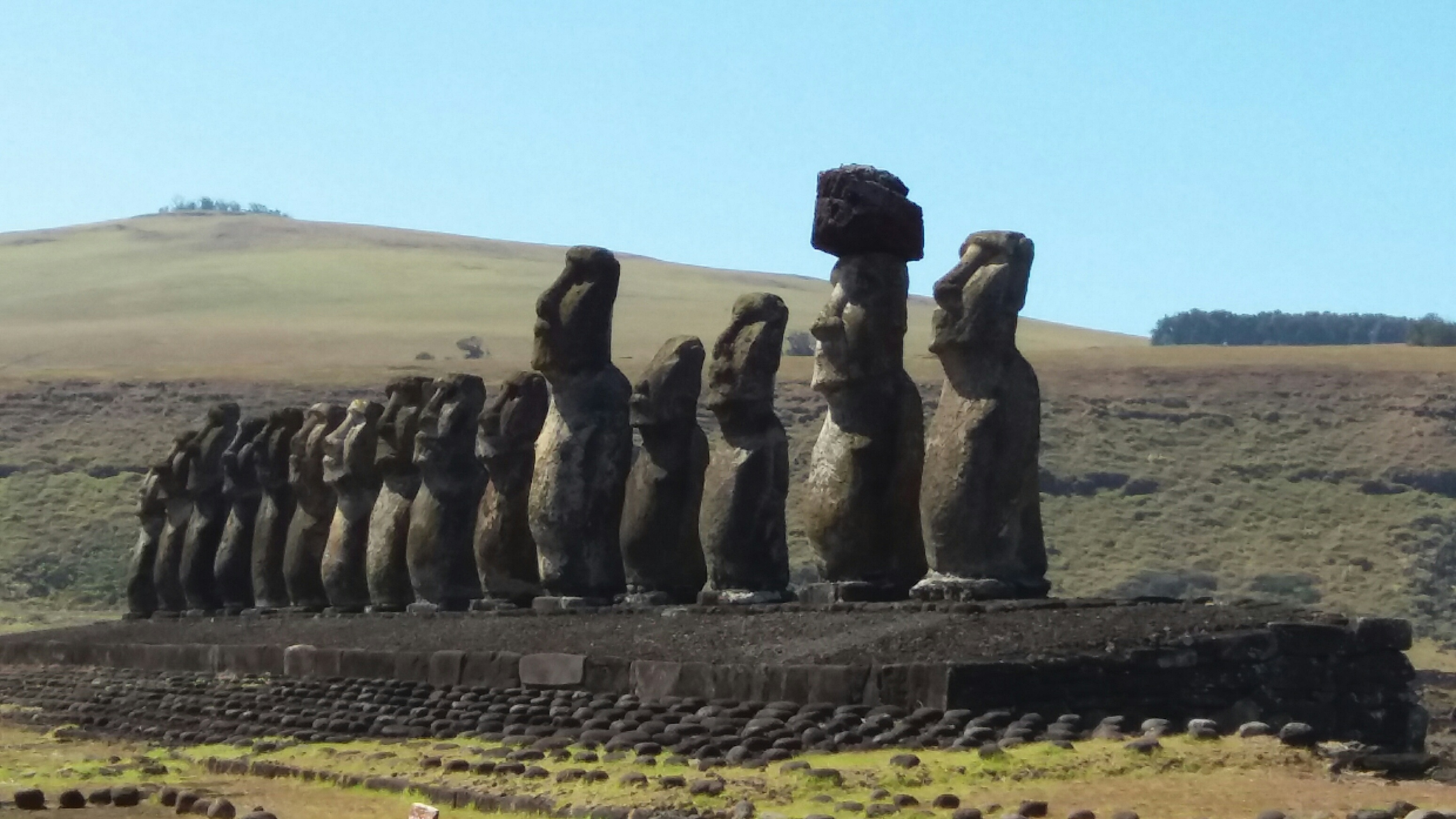 Tongariki, 15 Moai on an Ahus (stone platform). A Japanese company sponsored the reassembly of this site.