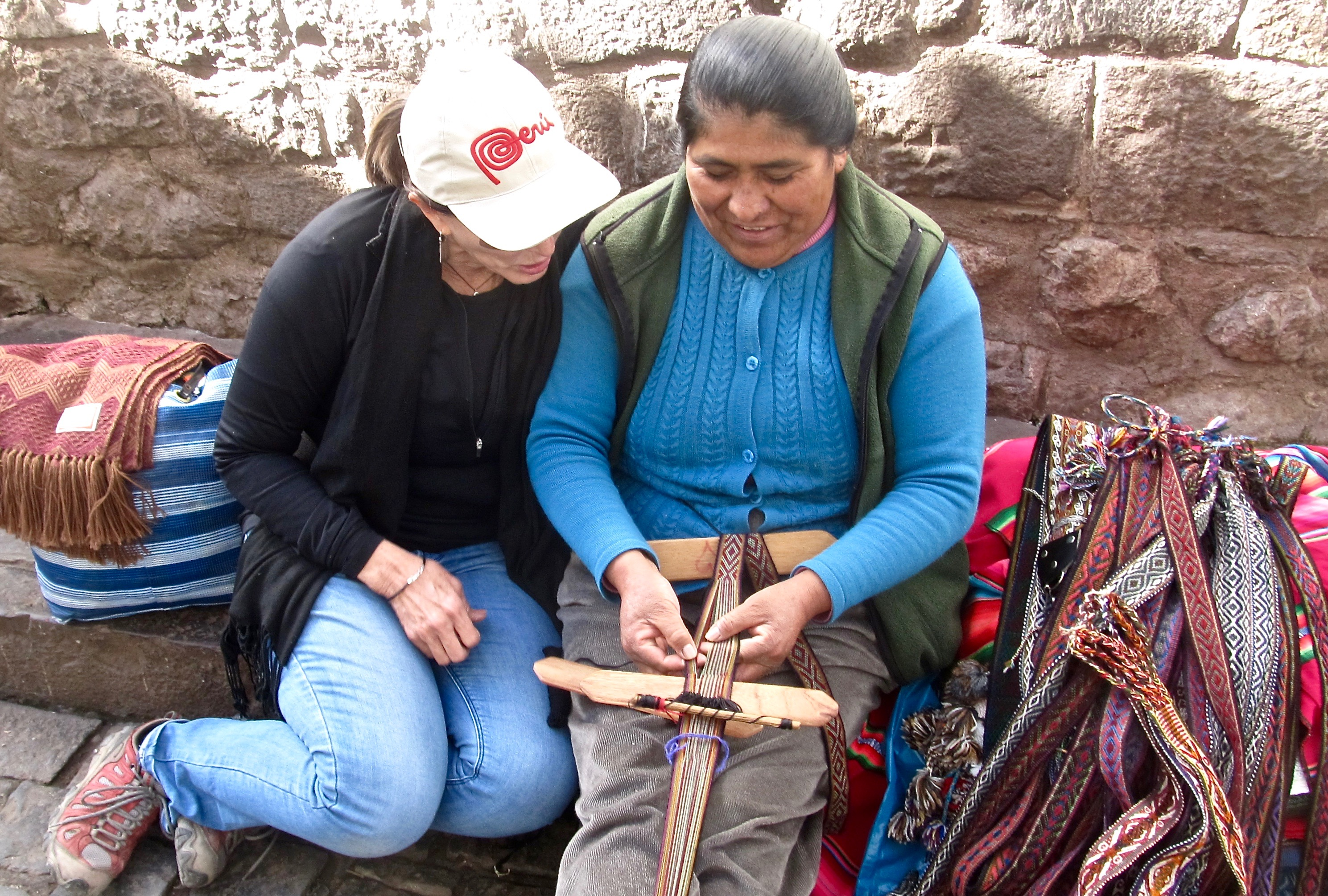 Every day Maria sits on the curb in Cusco and weaves. I sat down with her. I bought a belt. We became friends.
