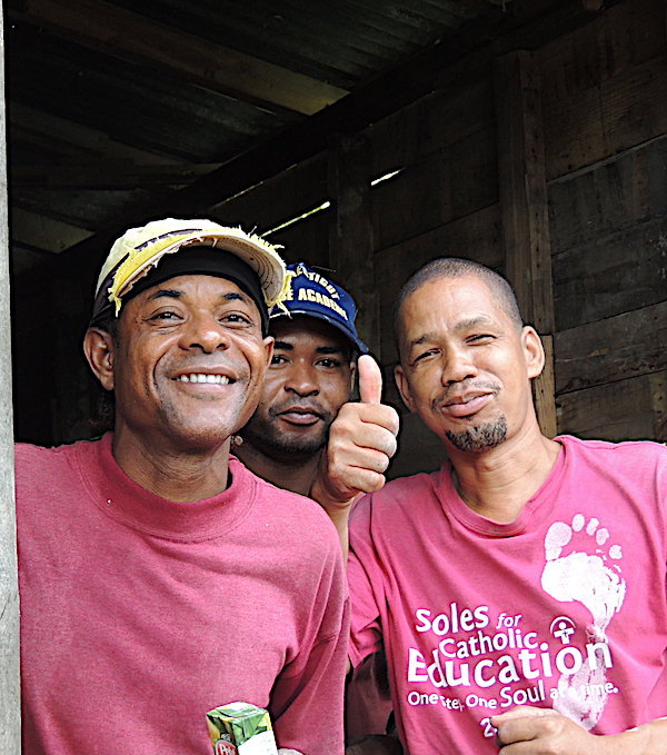 Santos (right) and workers. They worked so hard. There was no ventilation in the house. High humidity. They never stopped.
