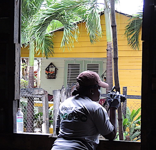 Sara Bell taking pictures from the window of the house.