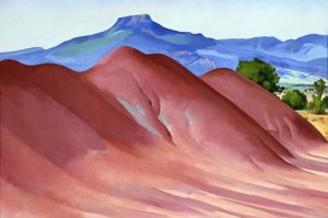 The focus in this O'Keeffe painting are the red hills. Pedernal Mountain in the background could easily be missed.