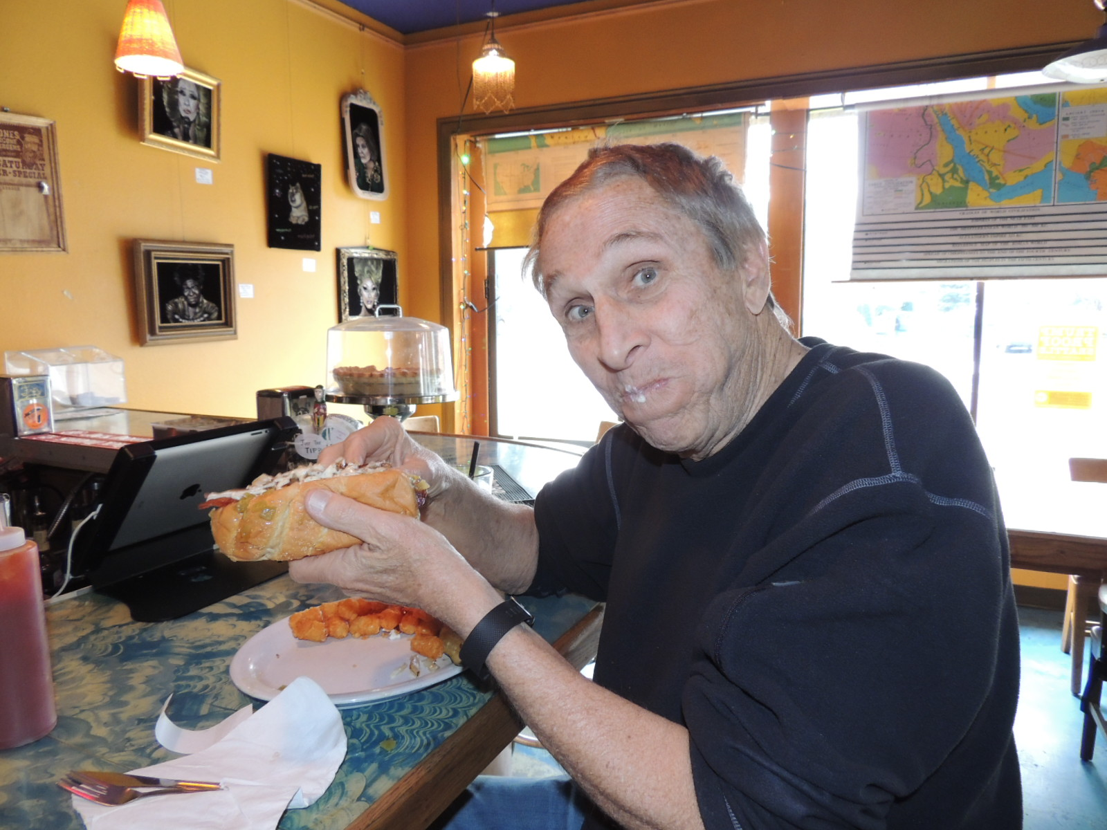 Bruce Wienke preparing to consume one of Cafe Racer's Wonder Wiener.