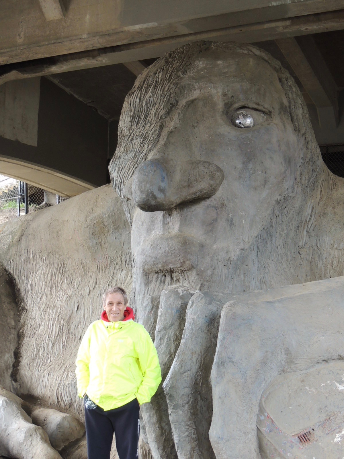 Bruce Wienke standing in front of the troll.