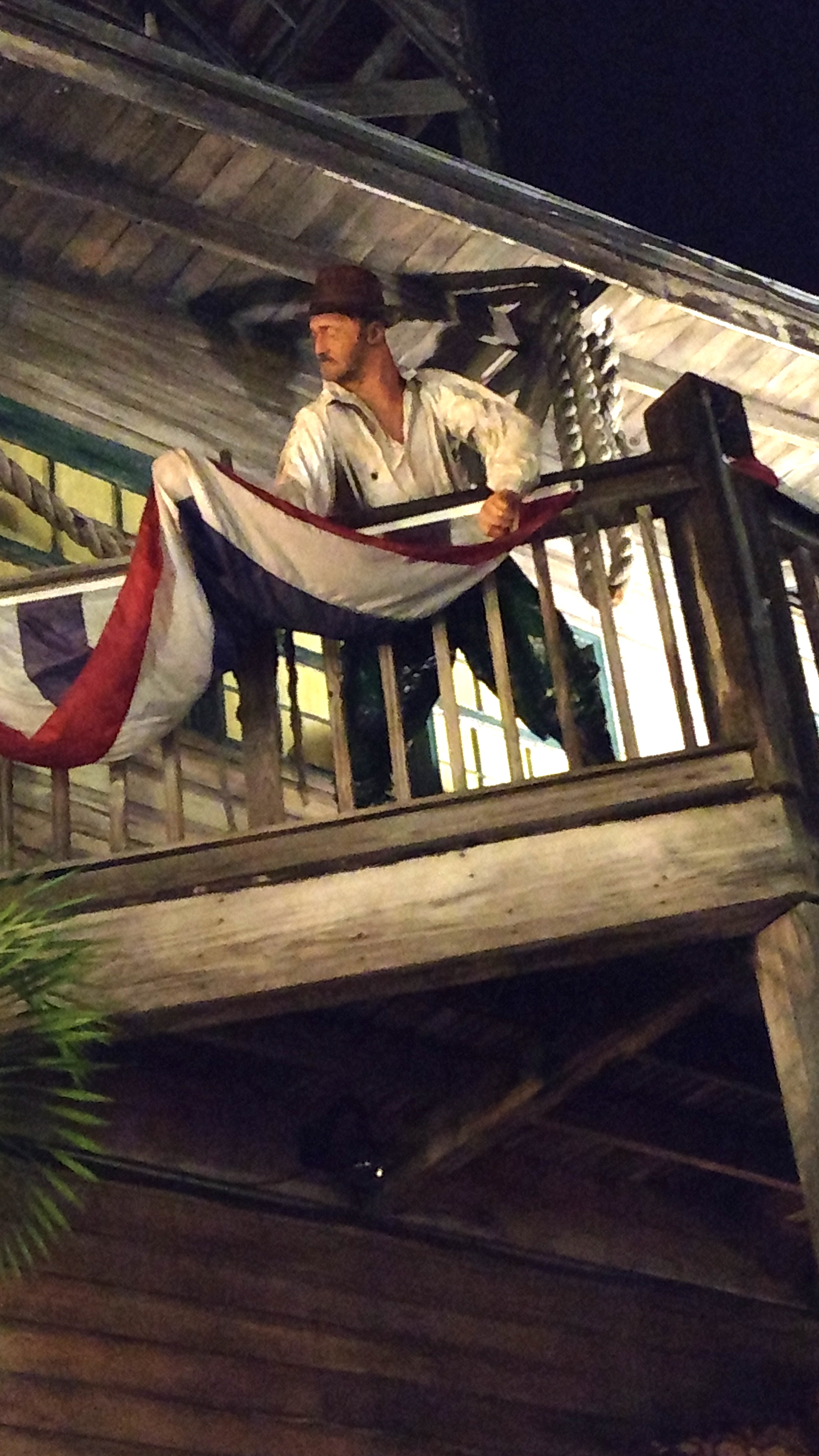 A mannequin stands on the balcony of the Shipwreck Treasures Museum.