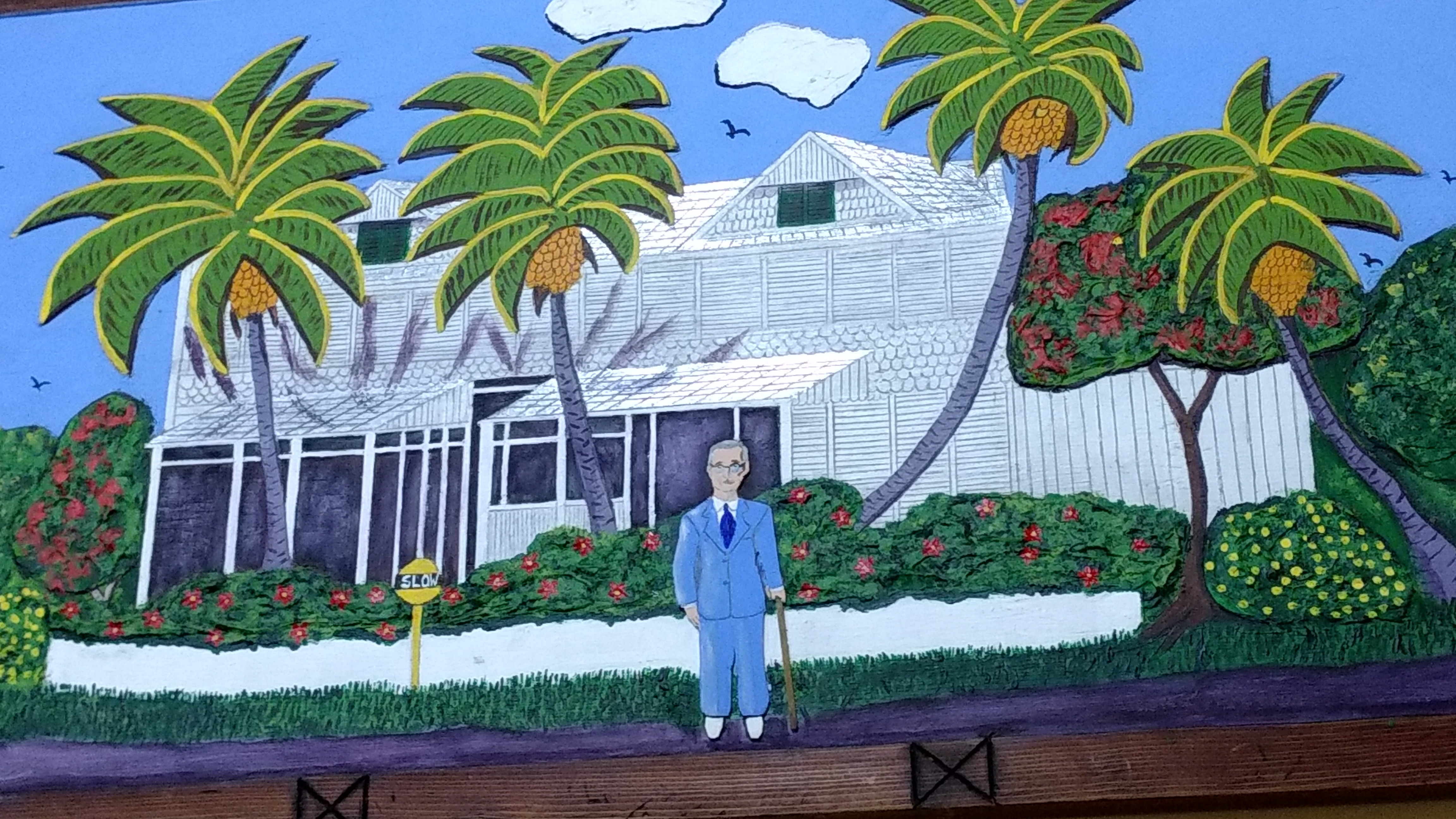 a painting of Truman in front of the Little White House located in the exhibition room.
