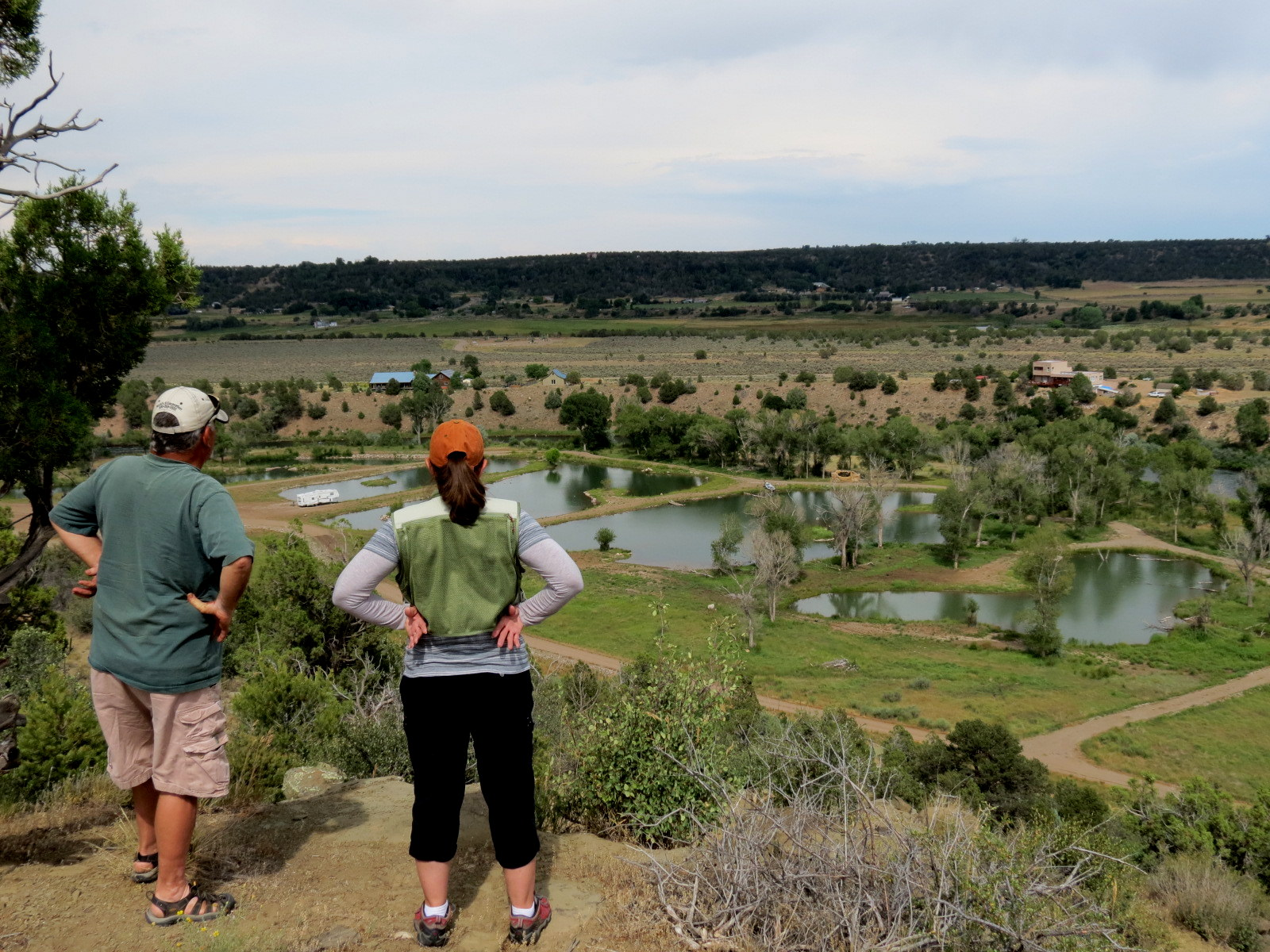 Annie and Lonnie looking at Little Fishes from the hill above the property.