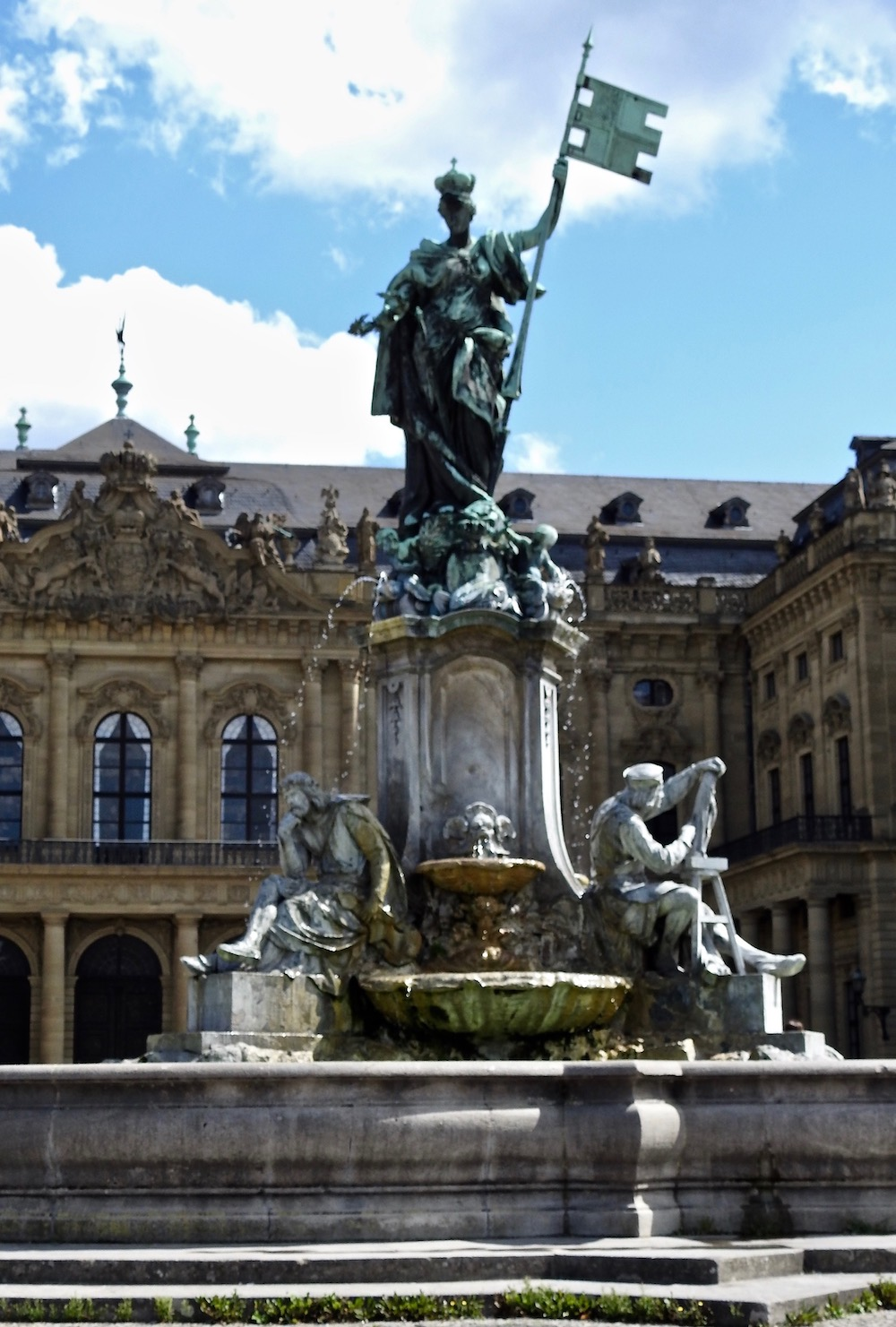 Franconia tops the fountain in front of Wurzburg Residenz