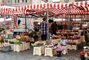 One of the red and white canopies of a flower vendor in Market Square.