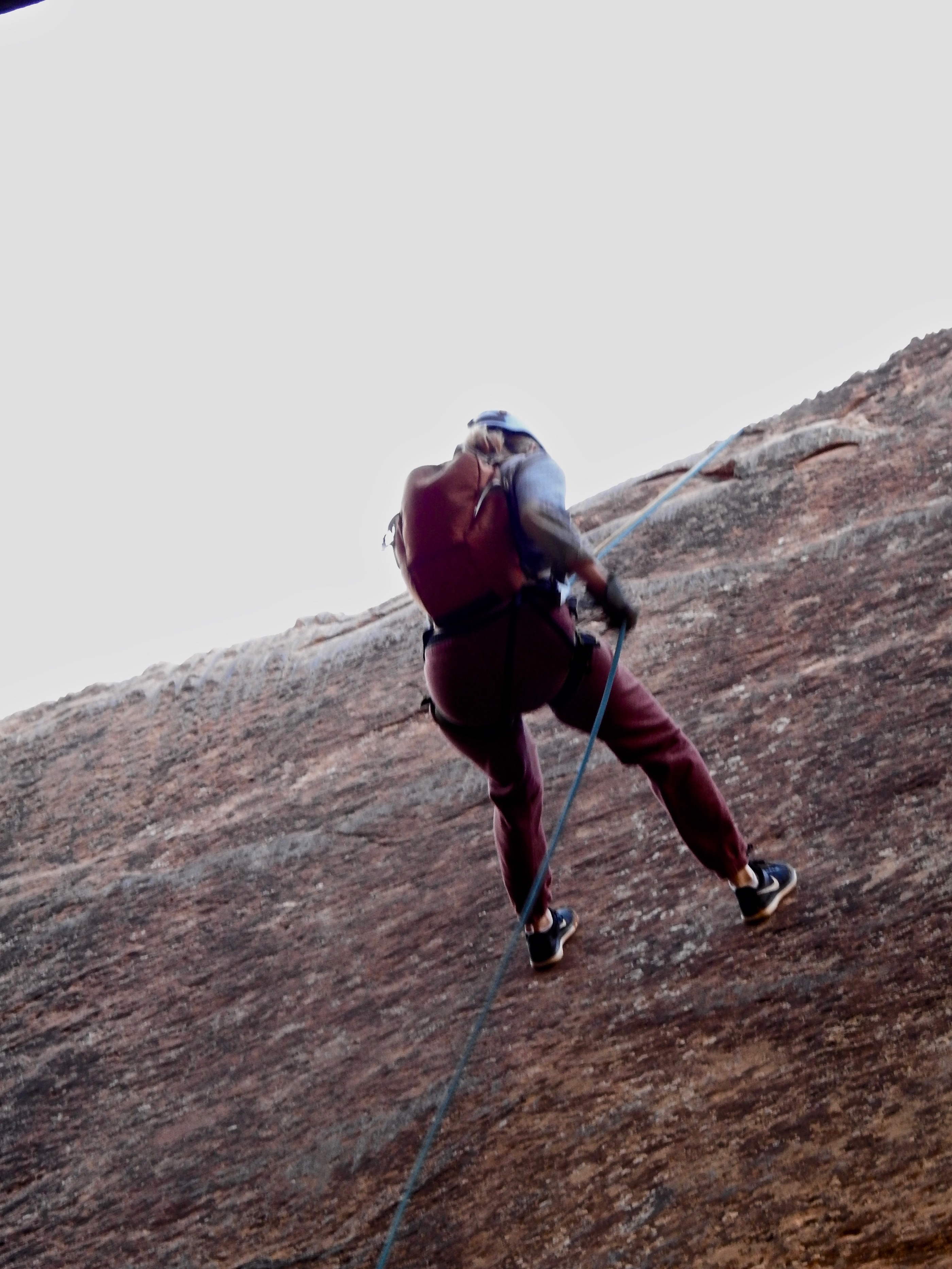 Hilary rappelling.