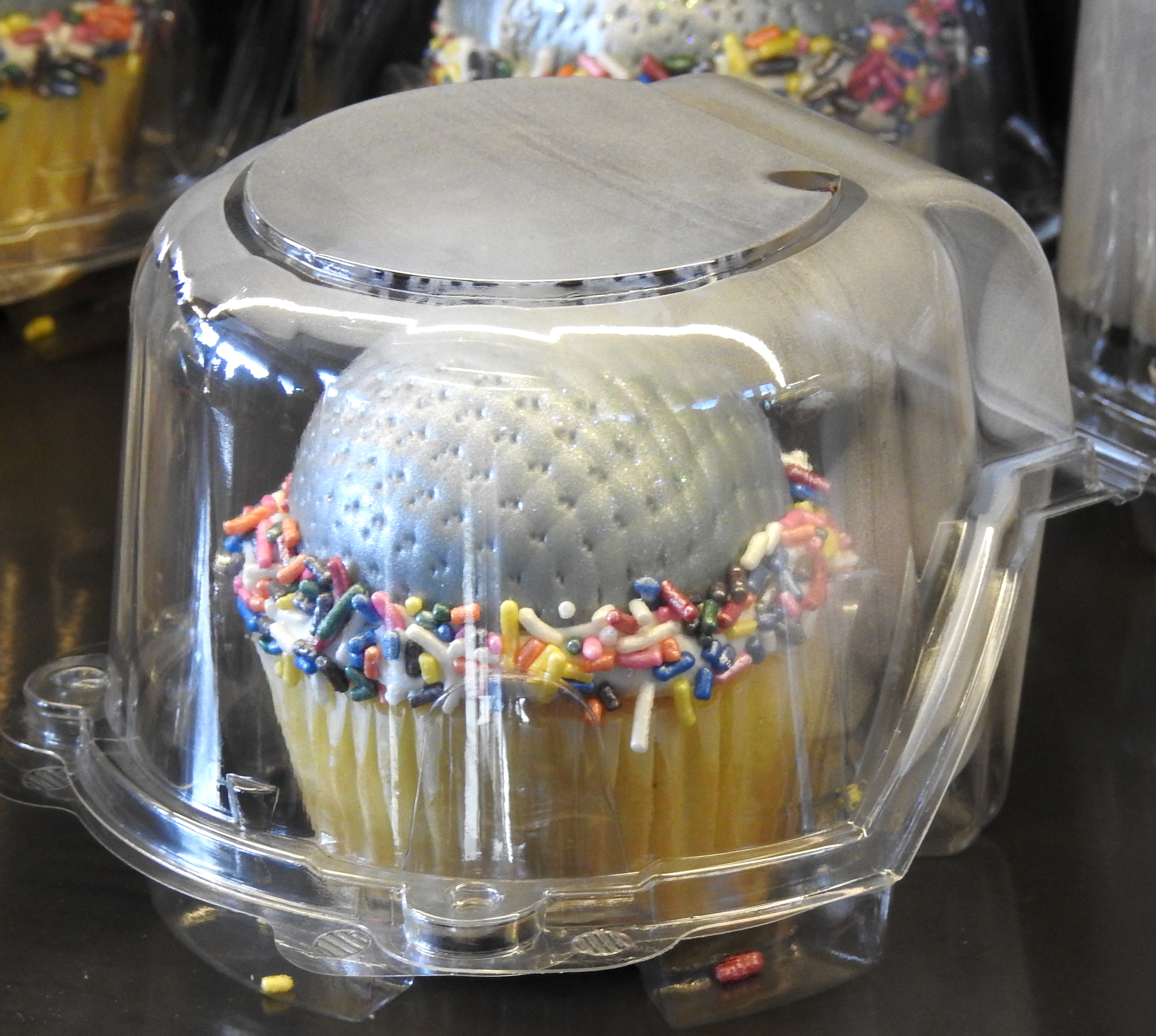 A cupcake at Starbucks in the shape of the golf ball, the Epcot symbol.