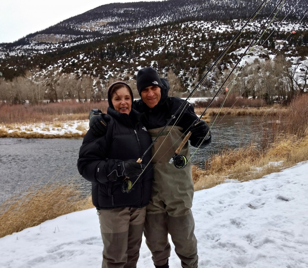 Annie and Bruce, with fly fishing rods in hand, are ready to wade into Spring Creek to catch rainbow trout.