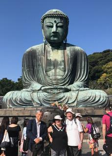 At the Great Buddha Of Kamakura with our guide.