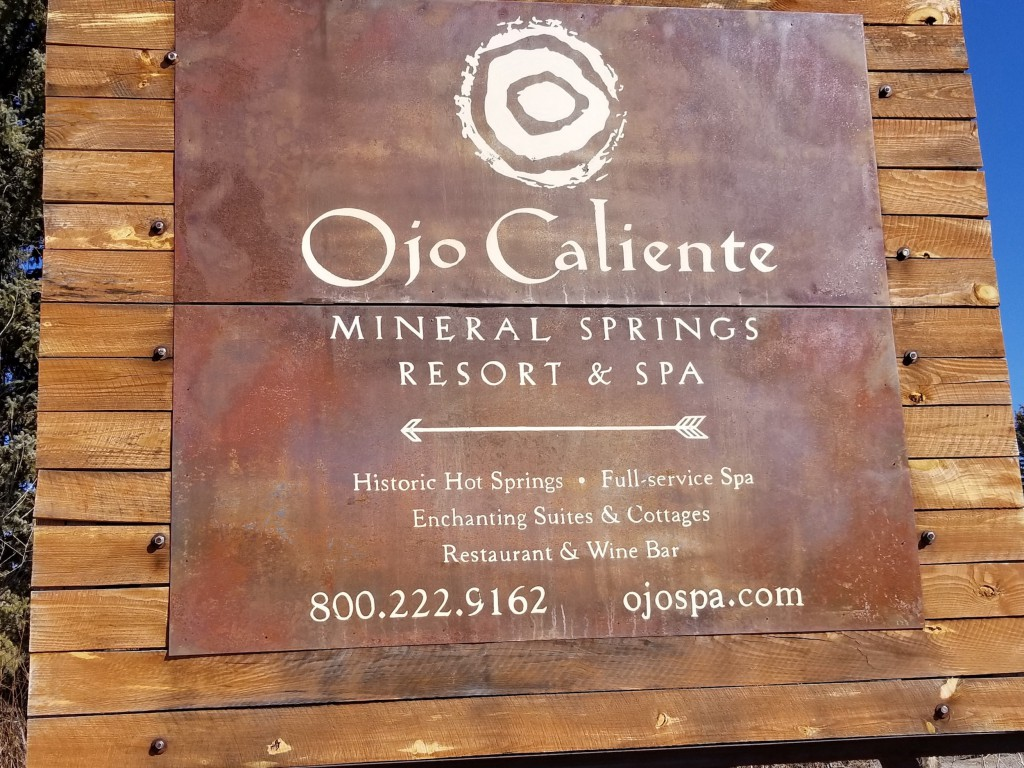 The sign at the entrance of Ojo Caliente
