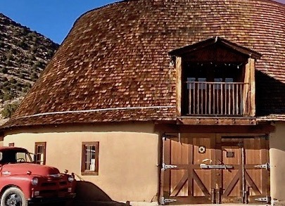 Adobe round barn built in 1924, restored in 2002. Originally used as a diary barn.