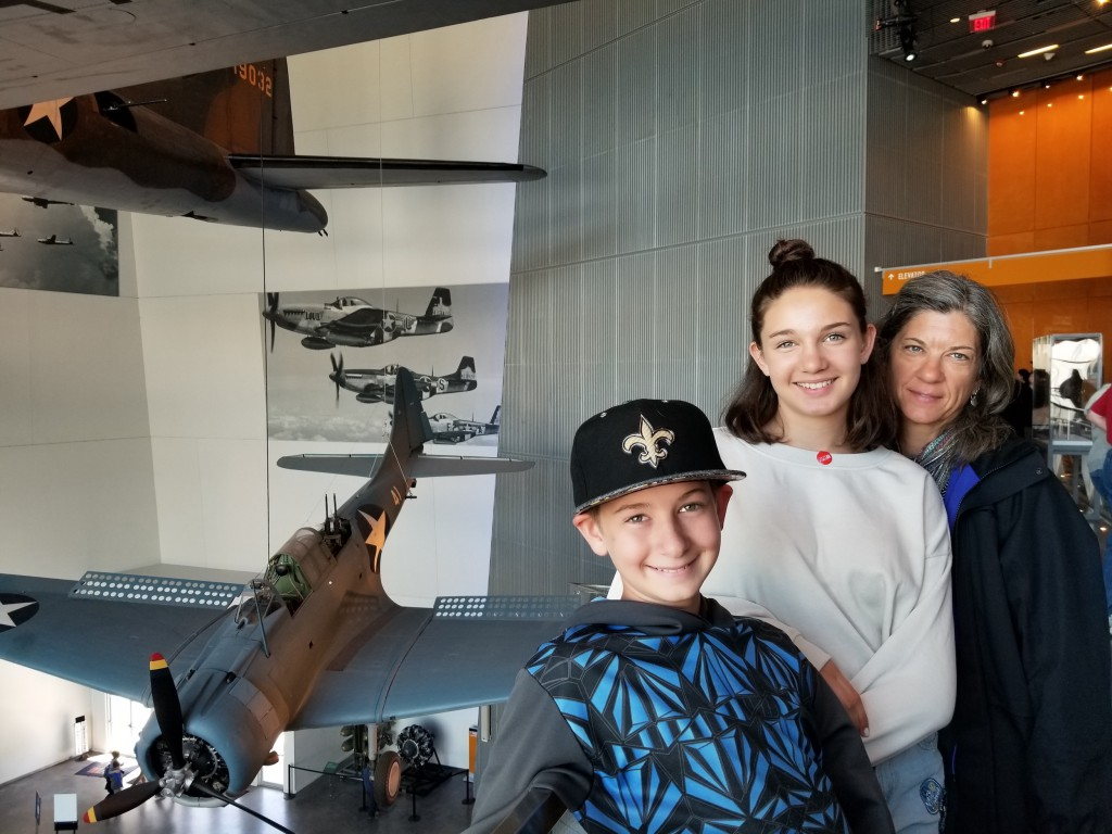 On the balcony overlooking the display of airplanes. One of my favorite areas of the WWII museum.