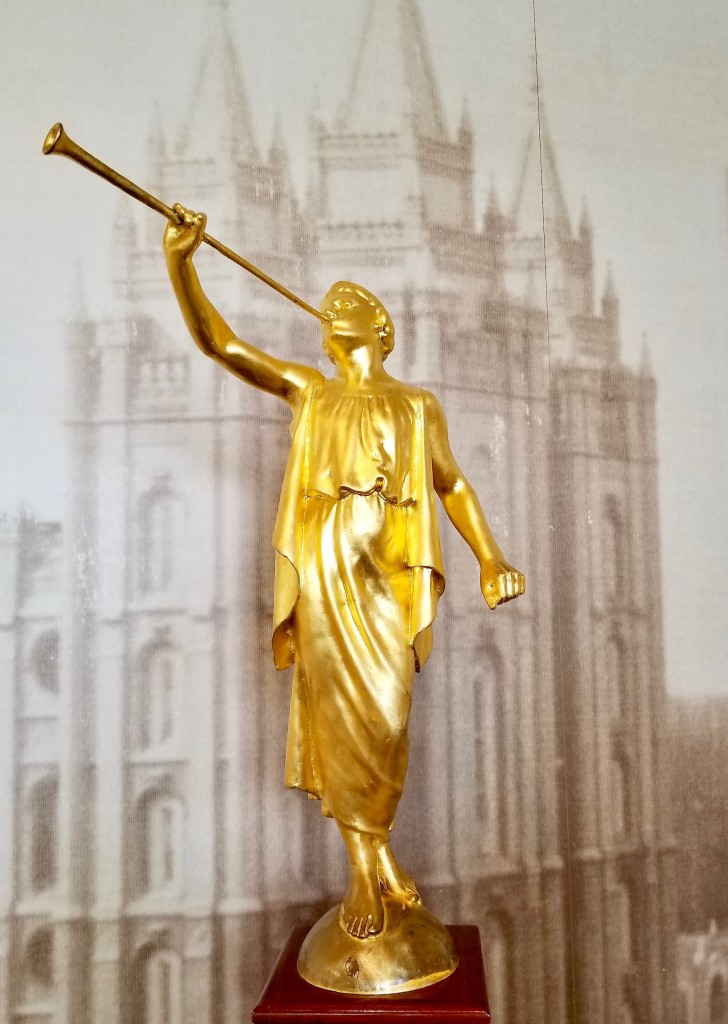 The gold-leafed Angel Moroni, sits on high of the center east tower to the Temple was created by Cyrus E. Dallin.
