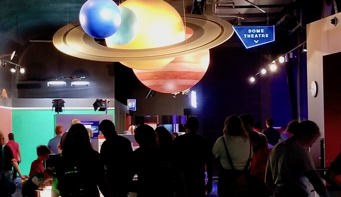 Planets hover over one of the activity rooms at the Clark Planetarium