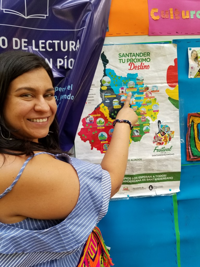 Naly, our teacher, pointing out points of interest on the map in Parque San Pio