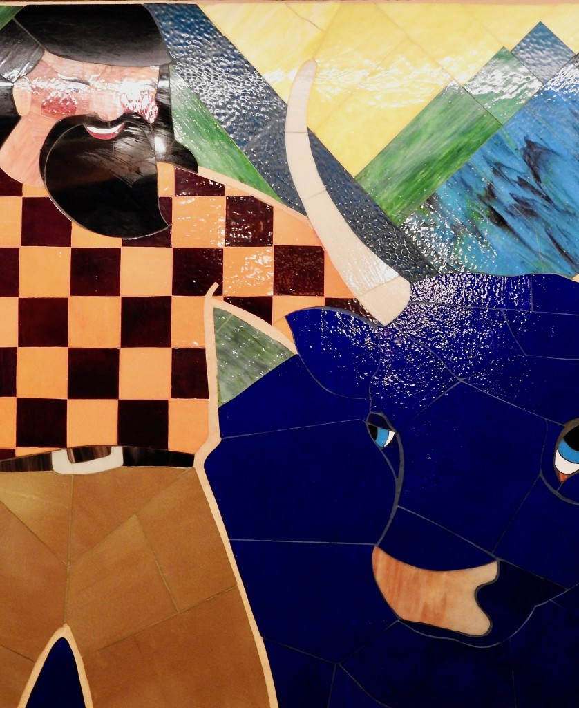 Completed mosaic of Babe the Blue Ox and Paul Bunyan.
