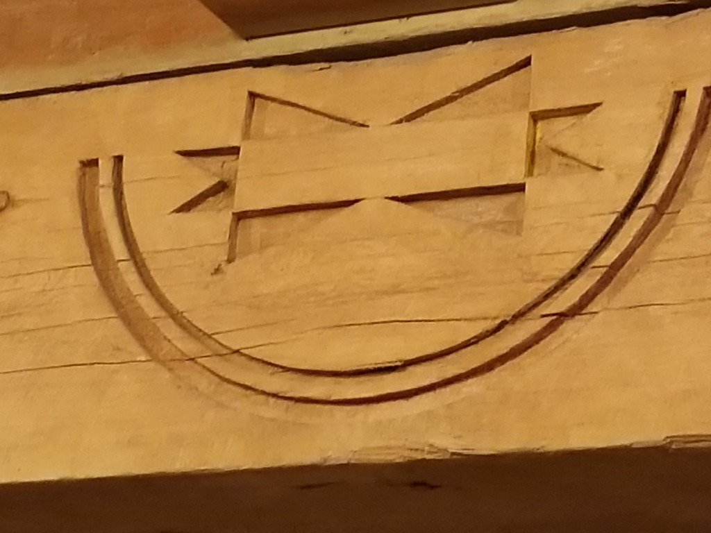 Carved Indian symbols.