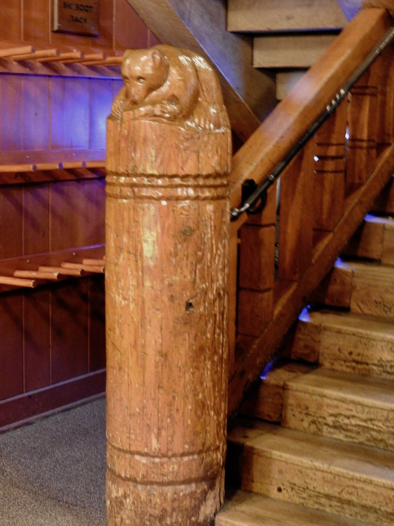 Newels at the stairs depict animals indigenous to the area.